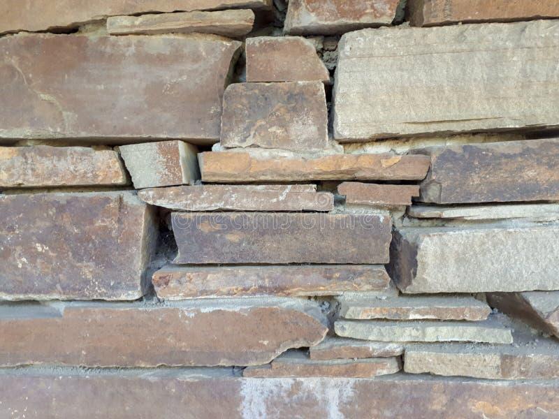 Een muur van grijze steen bricklaying royalty-vrije stock foto
