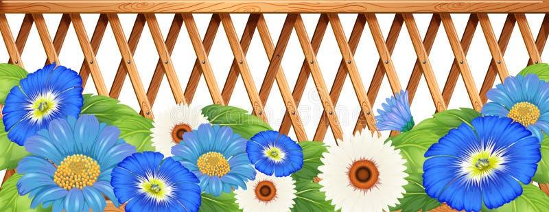 Een omheining met blauwe en witte bloemen royalty-vrije illustratie