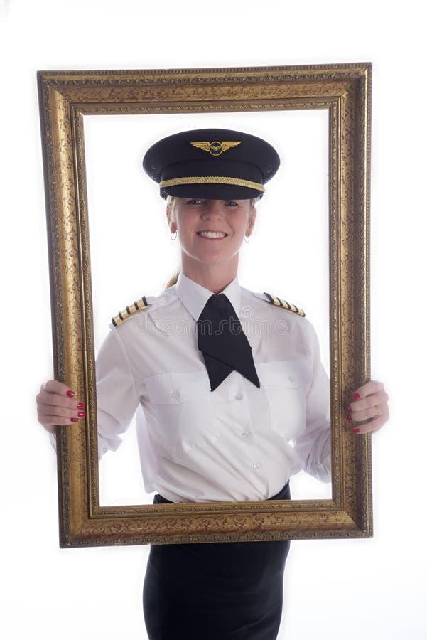 In een omlijsting vrouwelijke luchtvaartlijn proef stock foto's