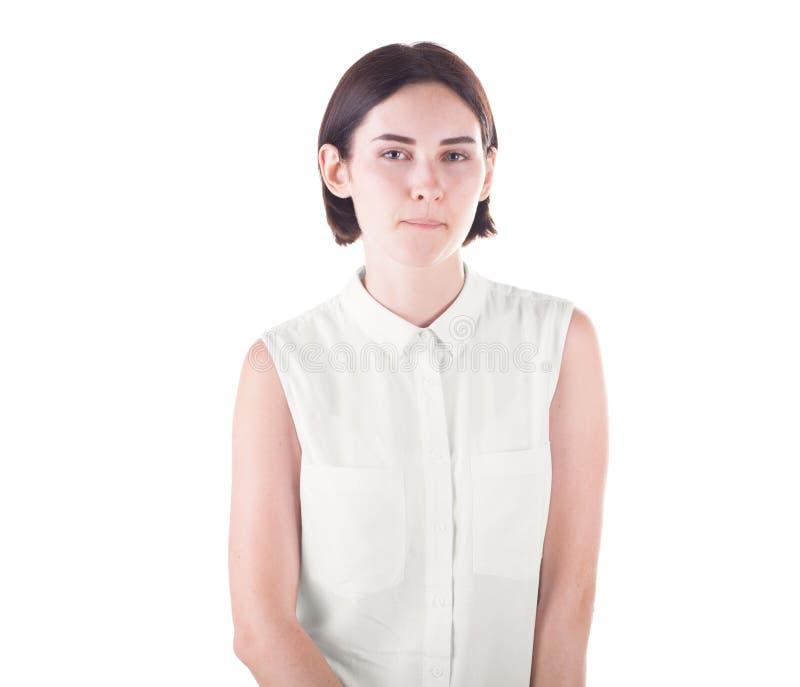 Een onhandige die dame op een witte achtergrond wordt geïsoleerd Een grappig en nieuwsgierig meisje Een mooie dame in een witte b stock fotografie
