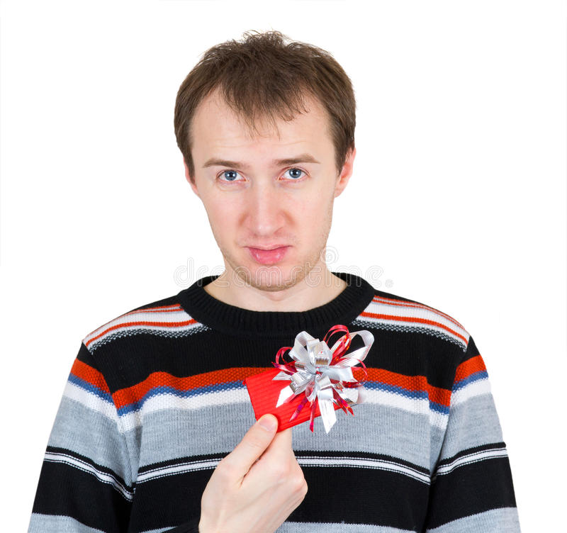 Een ontevreden mens die een kleine gift houdt stock fotografie