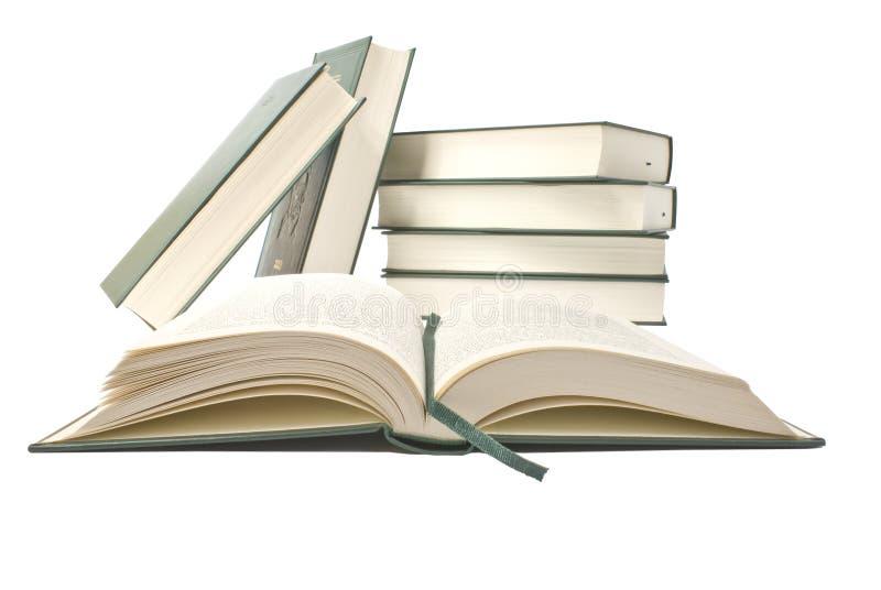 Een open boekzitting op een witte achtergrond royalty-vrije stock afbeeldingen