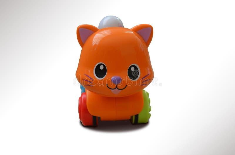 Een oranje kleurenstuk speelgoed kat stock foto