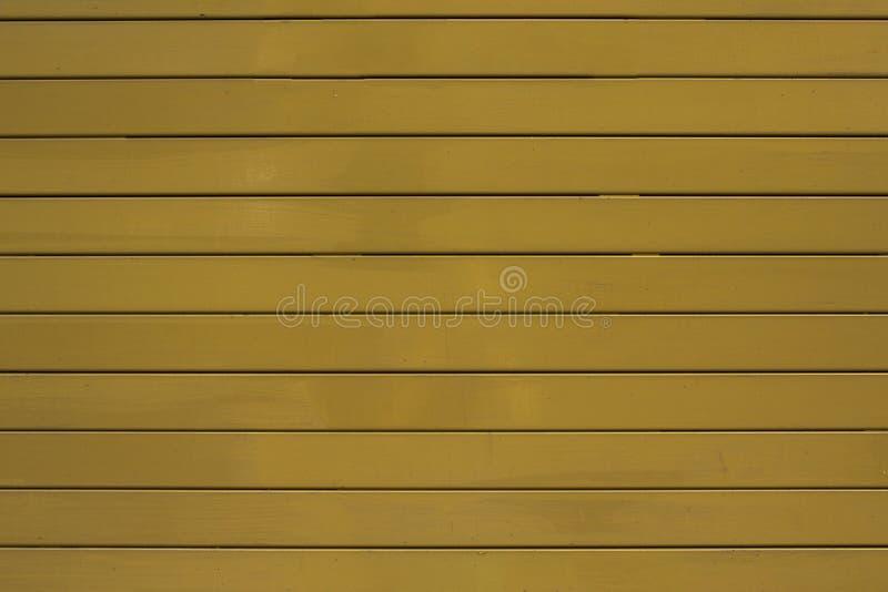 Een oude gele metaaljaloezie Horizontale lijnen Ruwe Oppervlaktetextuur royalty-vrije stock afbeelding
