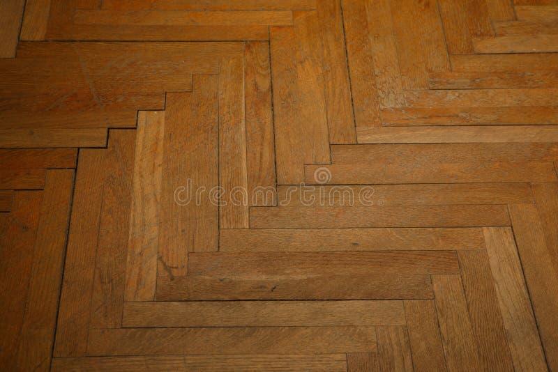Een oude houten parketachtergrond stock afbeelding