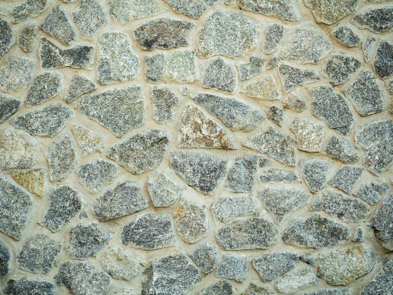 Een oude structuur van de steenmuur, sluit omhoog mening De textuur van de rotsmuur abstracte achtergrond Oude muuroppervlakte Gr stock afbeelding