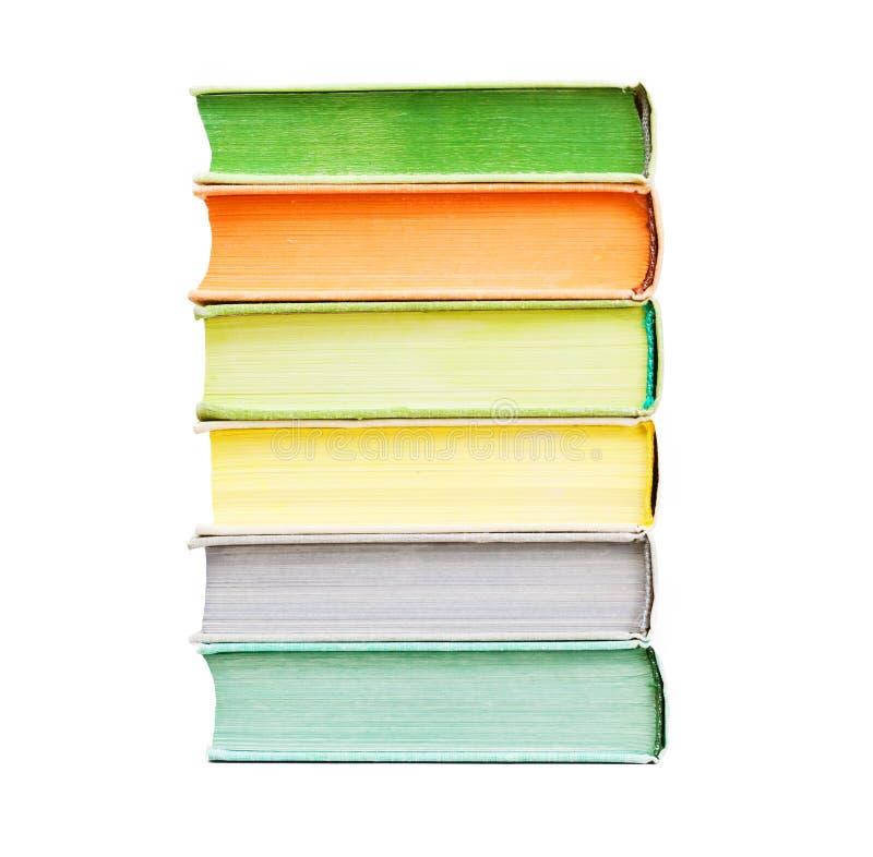 Een paar die boeken op witte achtergrond worden geïsoleerd stock fotografie