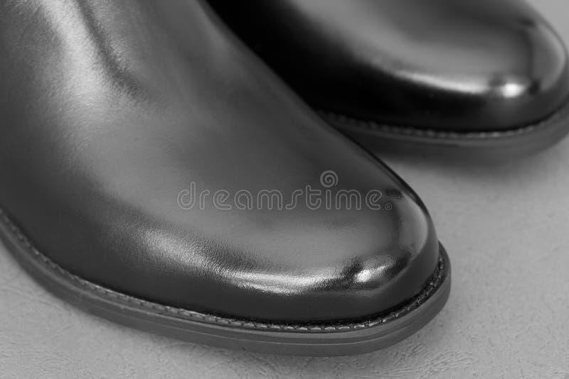 Een paar glanzende laarzen royalty-vrije stock fotografie