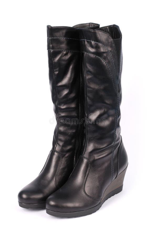 Een paar zwarte laarzen van leervrouwen ` s royalty-vrije stock afbeelding