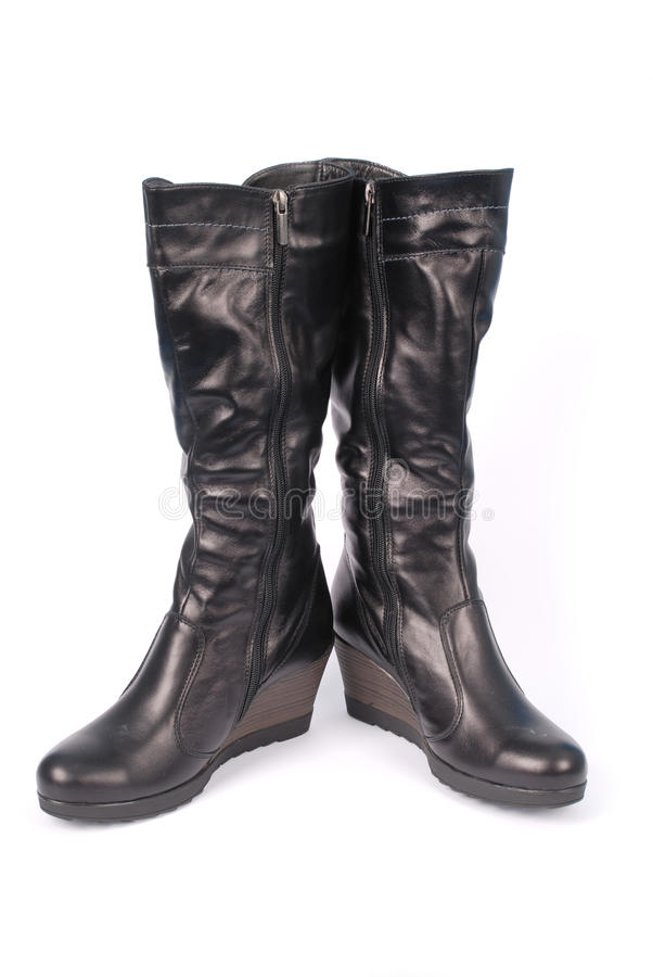 Een paar zwarte laarzen van leervrouwen ` s stock afbeelding