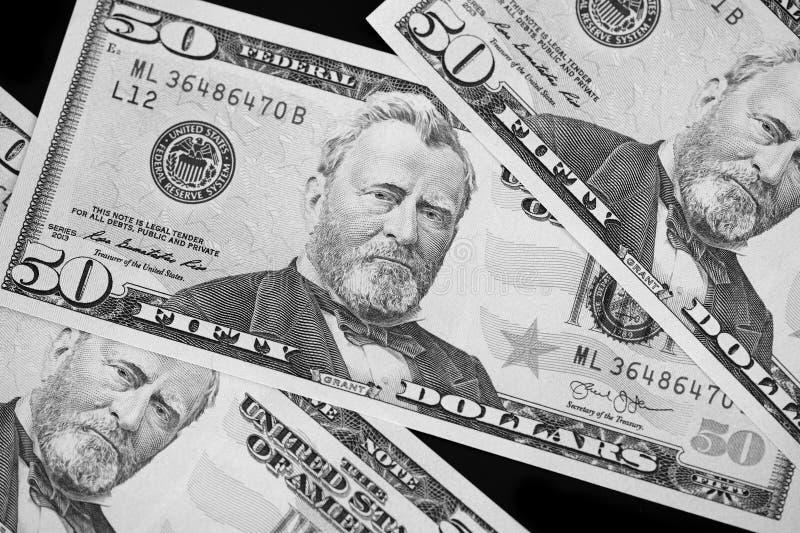 Een pak van vijftig dollarsrekeningen op donkere dichte omhooggaand als achtergrond Rebecca 36 stock afbeelding