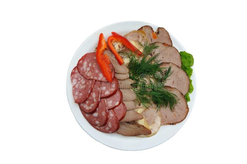 Een plaat van delicatessen, gesneden vlees en worst royalty-vrije stock afbeeldingen