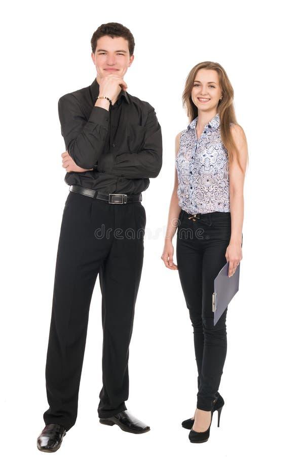 Een portret van een onderneemster en een zakenman die zich geheel bevinden stock fotografie