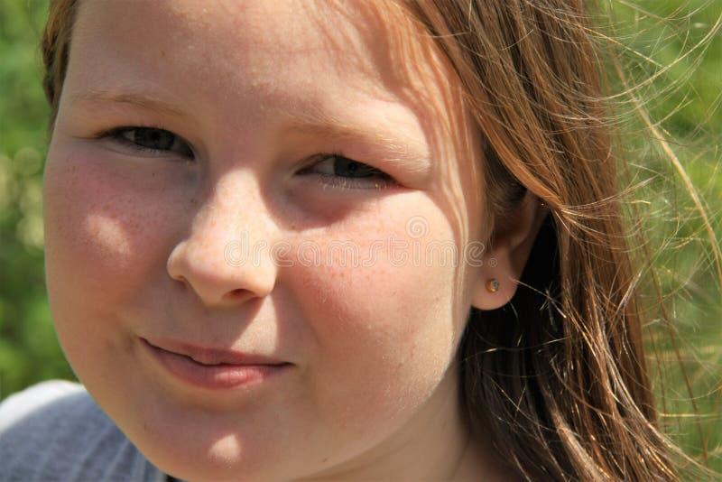 Een portret van een freckled meisje royalty-vrije stock foto
