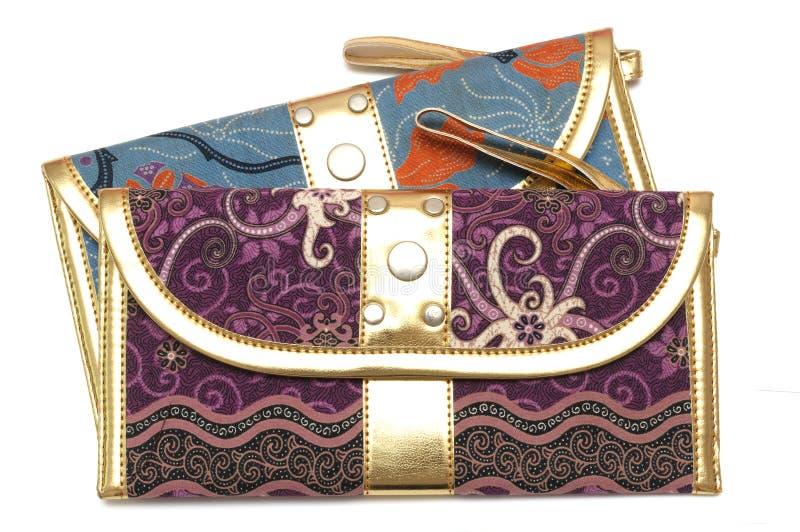 Een purpere en blauwe zak met ritssluitingstrekker royalty-vrije stock afbeeldingen
