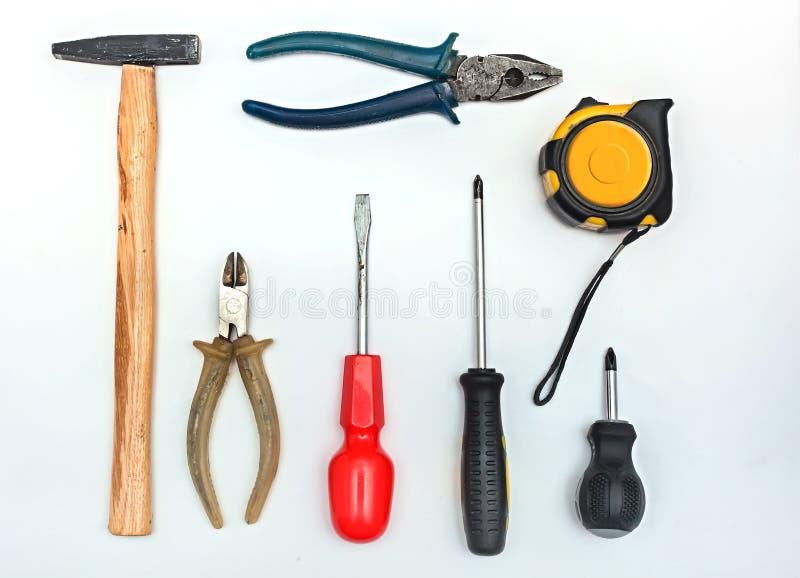 Een reeks hulpmiddelen op een witte achtergrond stock fotografie