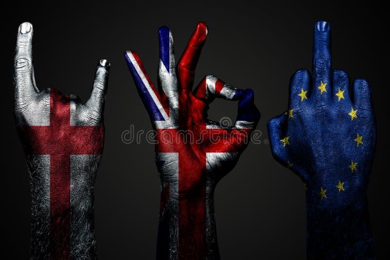 Een reeks van drie handen met een geschilderde vlag van de Europese Unie van Engeland, van het Verenigd Koninkrijk en toont midde stock fotografie