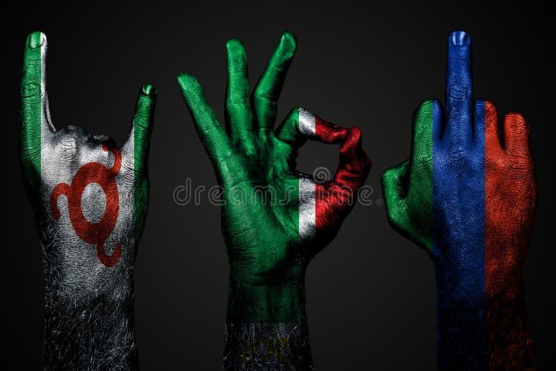 Een reeks van drie handen met een geschilderde vlag van Ingushetia, Dagestan en Tchetchenië tonen middelvinger, geit en O.k., een royalty-vrije stock afbeelding
