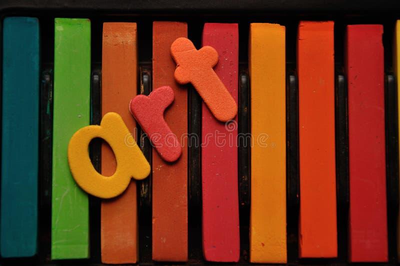 Een rij van pastelkleuren met het woordart. royalty-vrije stock foto's
