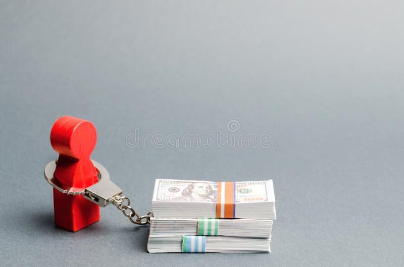 Een rode mens de handboeien om:doen aan een geld Afhankelijkheid van financiën Geaccumuleerde schulden Onvermogen om leningen ter stock foto
