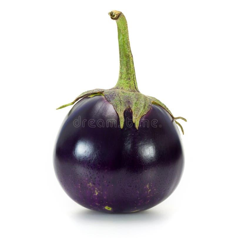 Een ronde aubergine stock afbeeldingen