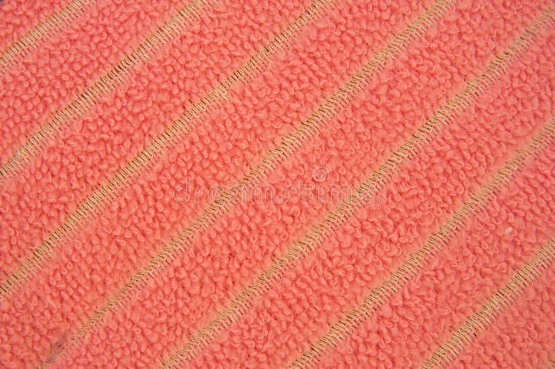Een roze microfiberhanddoek. royalty-vrije stock afbeeldingen