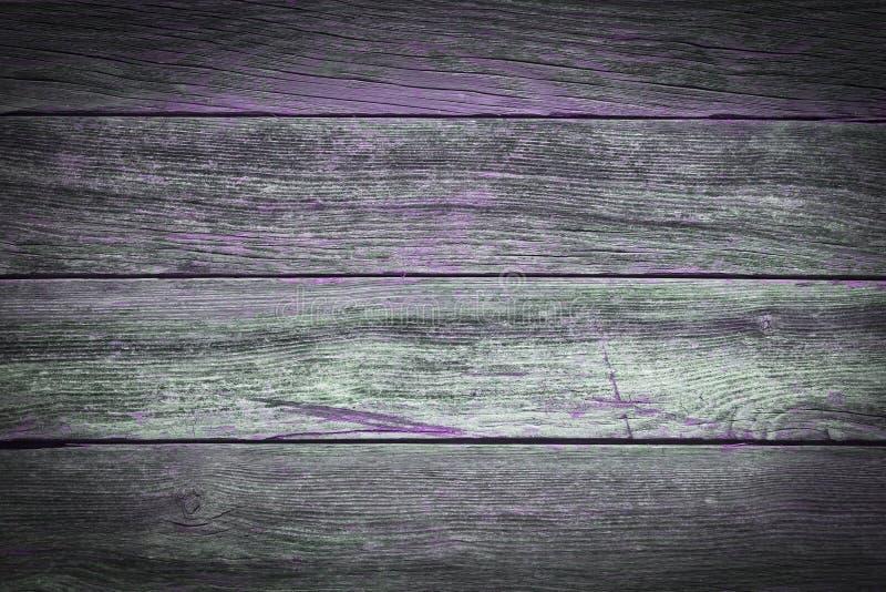 Een rustieke houten achtergrond met purpere details royalty-vrije stock foto's