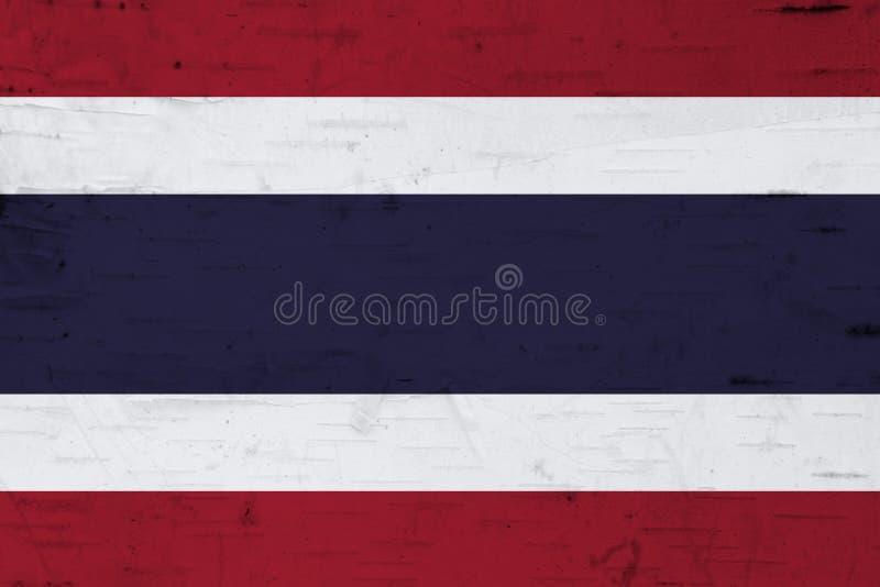 Een rustieke oude vlag van Thailand op doorstaan hout royalty-vrije stock afbeeldingen