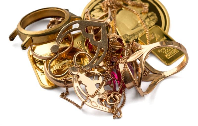 Een schroot van goud Oude en gebroken juwelen, horloges van gouden en verguld stock afbeeldingen