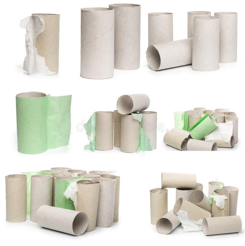 Een selectie van de buizen van het kartontoiletpapier in diverse die regelingen op een witte achtergrond worden geïsoleerd royalty-vrije stock foto