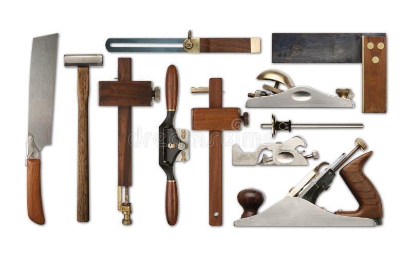 Een selectie van de hulpmiddelen van het precisietimmerwerk op een witte achtergrond stock afbeeldingen