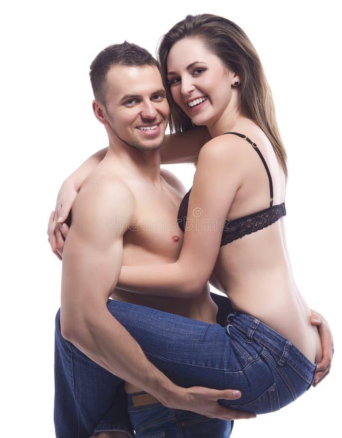Het sexy jonge topless paar omhelzen stock foto's