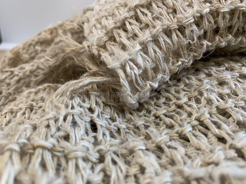 Een sjaal die van hennepstof, henneptextuur, natuurlijk patroon als achtergrond en behang maakte royalty-vrije stock foto