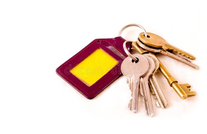 Een sleutelbos en sleutelring - Sleutel stock afbeelding