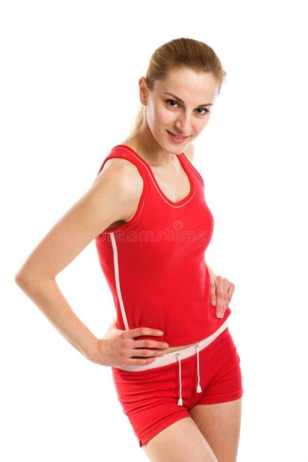Een sportieve blonde in rode maillot royalty-vrije stock foto