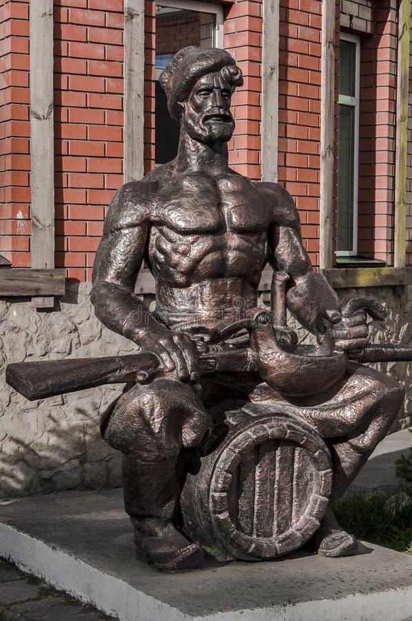 Een standbeeld van een Kozak met een kanon royalty-vrije stock afbeeldingen