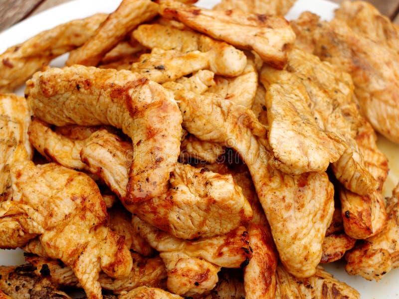 Een stapel van geroosterde vlees van pluimveeplakken Turkije stock foto's