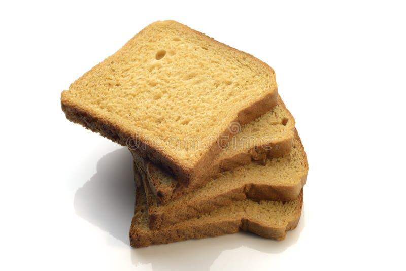 Een stapel van vers geheel tarwe bruin brood op witte achtergrond royalty-vrije stock fotografie