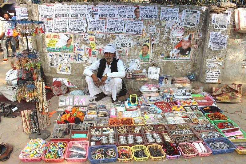 een straatverkoper in New Delhi, India stock afbeelding