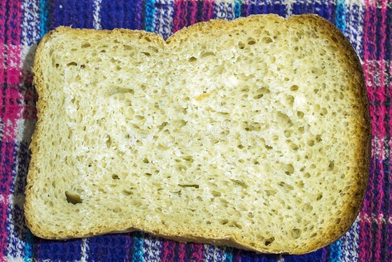 Een stuk van brood royalty-vrije stock afbeelding