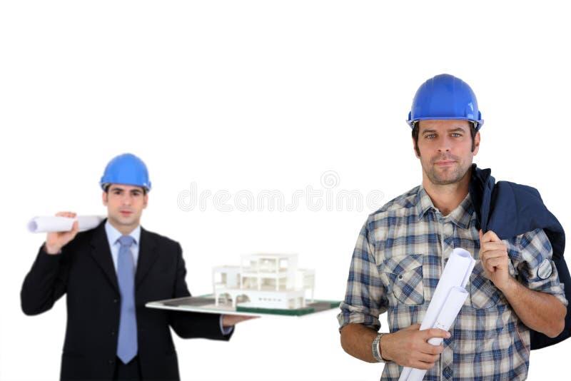 Een team van architecten stock afbeeldingen