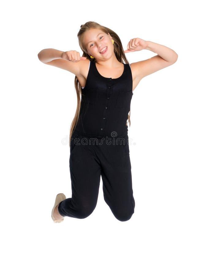Een tiener springt stock foto's