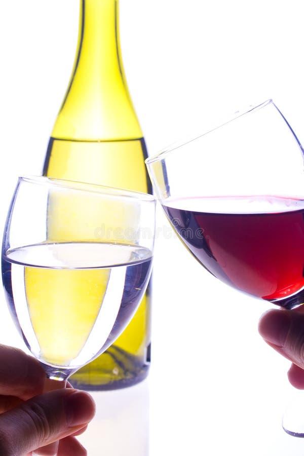 Een toost en een fles stock foto