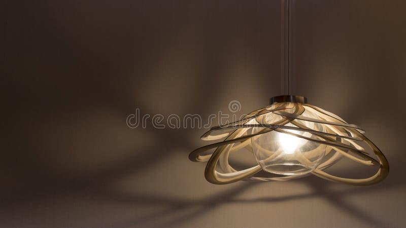 Een verlichte hangende lamp stock foto