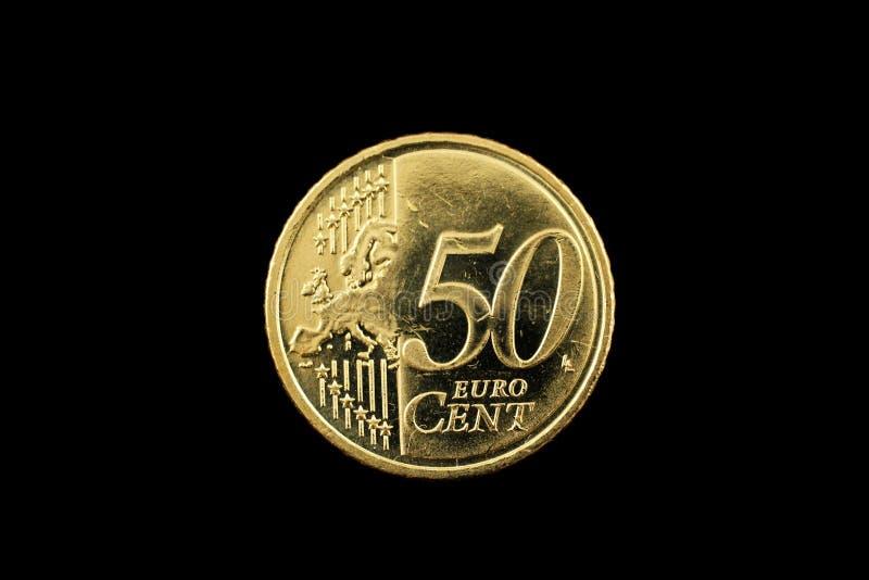 Een vijftig eurocentmuntstuk op zwarte royalty-vrije stock foto's