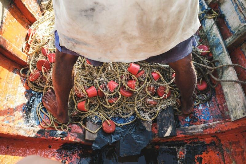 Een visser met hun net in Cabo DE La vela stock afbeelding