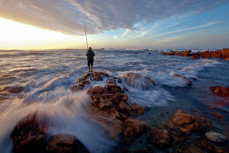 Een vroege visser die op grote wachten royalty-vrije stock afbeelding
