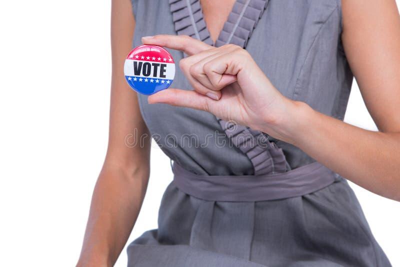Een Vrouw die stemkenteken tonen stock foto