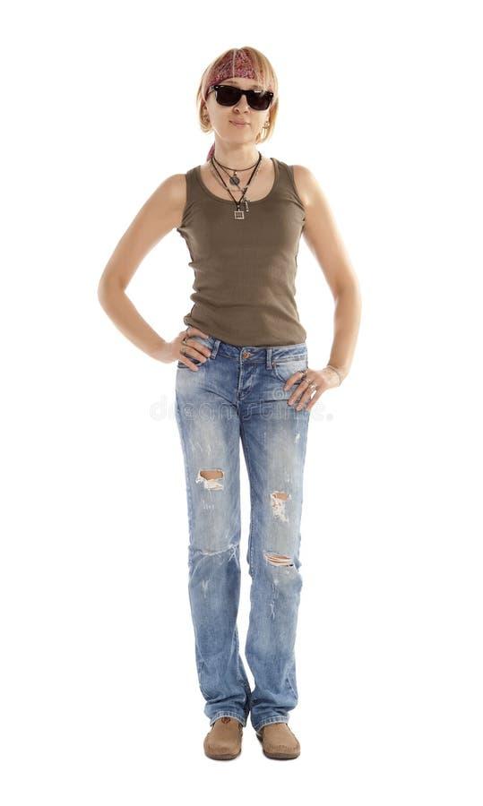 Een vrouw in gescheurde jeans royalty-vrije stock foto's
