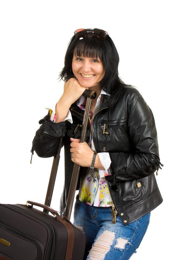 Een vrouw met een koffer royalty-vrije stock foto's